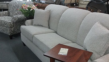 Grey contemporary sofa and patterned arm chair